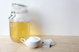 Kombucha jar with sugar and green tea