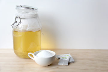 Kombucha jar with sugar and green tea