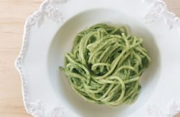 avocado basil pesto with spaghetti in a white bowl