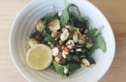 winter vegetables and chickpeas in a bowl with rocket and a slice of lemon