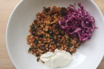 Greek Lamb Bake with Risoni, yoghurt and red cabbage salad in a white bowl