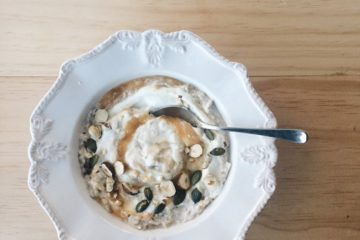 Autumn Bircher Muesli on a white bowl with a spoon