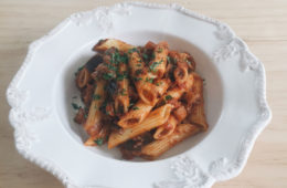 Tomato Porchini and Eggplant Penne on a white plate
