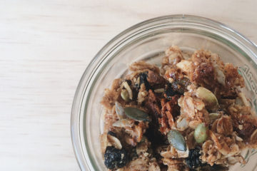 hazelnut and sour cherry granola in a weck jar on a wooden surface