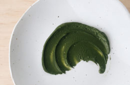 matcha face mask in a swirl on a white plate