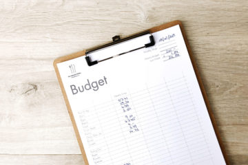 Budget Template filled out on a clip board
